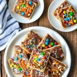 Chocolate covered graham crackers topped with M&M's sprinkles and pretzels