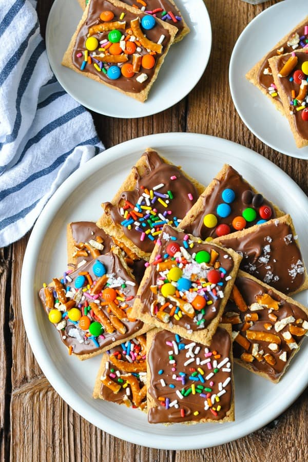 Chocolate covered graham crackers with peanut butter on a white plate