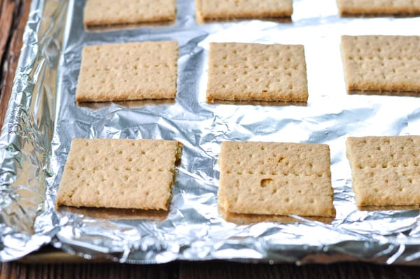 Graham crackers arranged on a baking sheet
