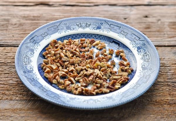 Plate of toasted chopped pecans