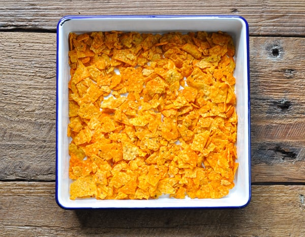 Crushed Doritos in a square baking dish