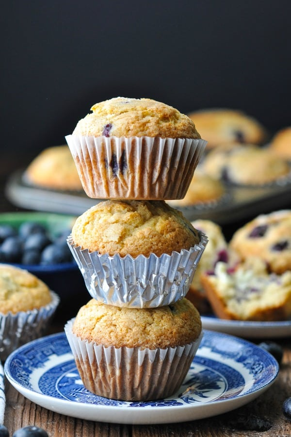 Stack of three homemade blueberry muffins on a plate