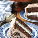 Front shot of a piece of easy chocolate cake with cream filling on a serving plate