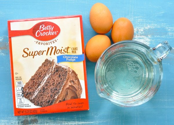 Ingredients for easy chocolate cake recipe with box of cake mix