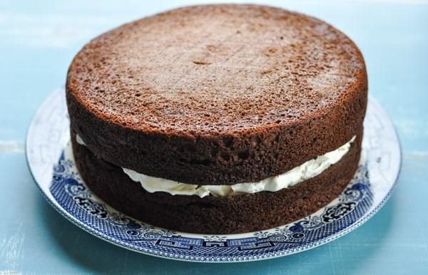 Process shot of layering classic chocolate cake recipe
