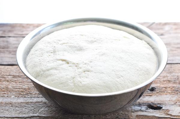 Dough rising in mixing bowl
