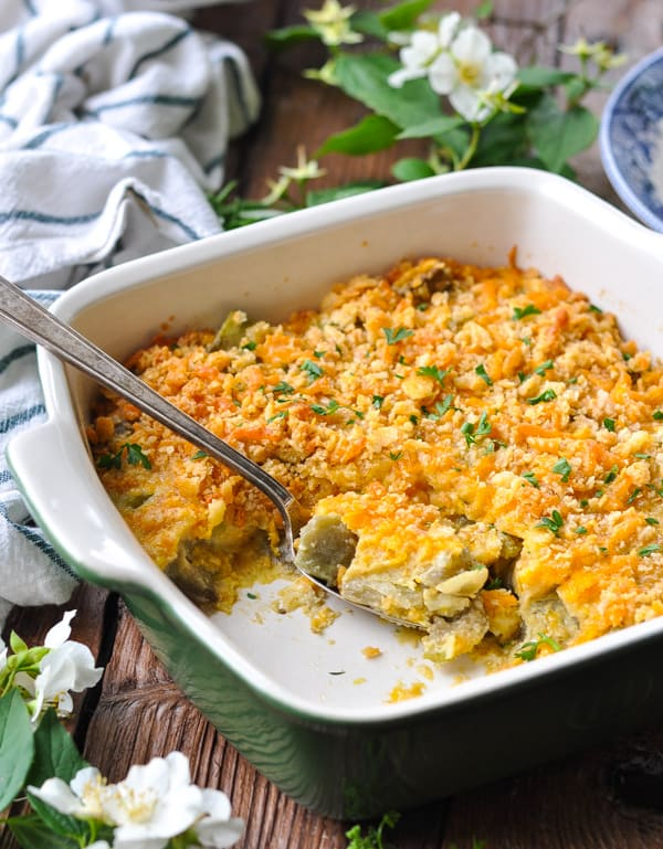 Side shot of a baked eggplant casserole in a green dish