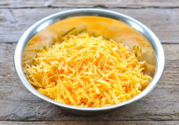 Grated cheddar in a large bowl