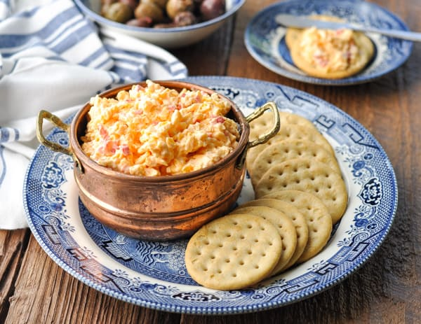 Horizontal shot of pimento cheese spread in a copper bowl