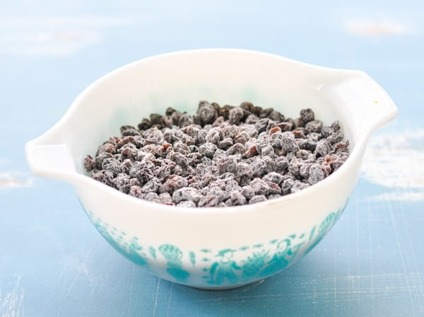 Small bowl of dried currants tossed with flour