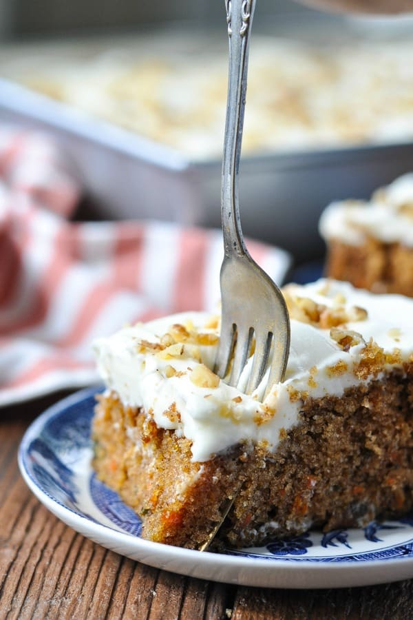 Fork digging into a slice of the best carrot cake recipe