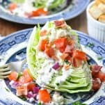 Front shot of classic wedge salad on a blue and white plate