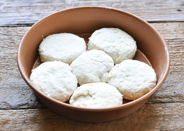 Homemade buttermilk biscuits in a round baking dish