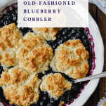 Overhead image of a pan of blueberry cobbler with a text title on top