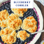 Overhead shot of blueberry cobbler with text title box on top of image