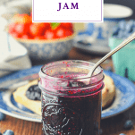 Front shot of a jar of homemade blueberry jam with a text title at the top