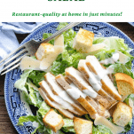 Overhead shot of a bowl of chicken caesar salad with text title at top