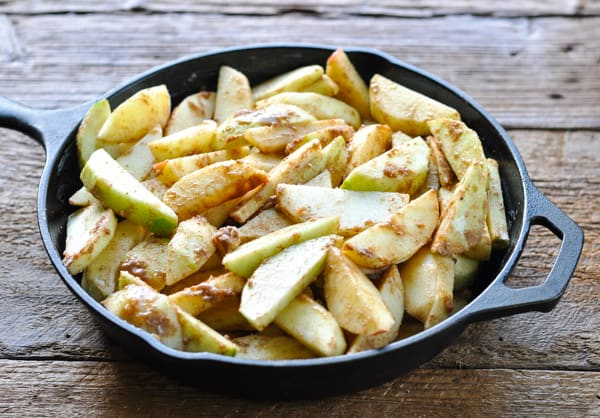 Sliced and spiced apples in a cast iron skillet