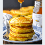 Close up shot of a stack of Hoe Cakes with honey and a text title below the image