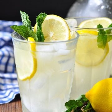 Two glasses of homemade lemonade garnished with fresh mint