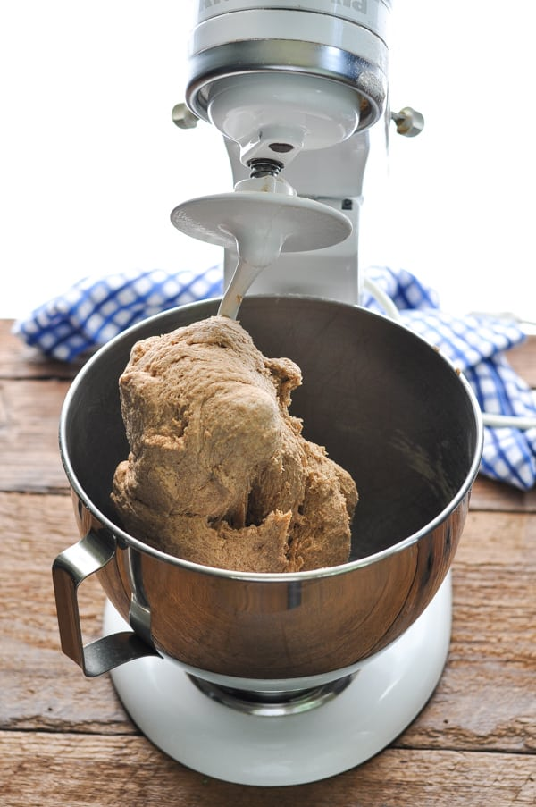 Kneading honey wheat bread dough in a stand mixer