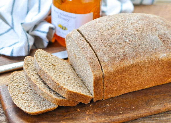 Horizontal shot of a sliced loaf of honey wheat bread