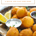 Front shot of a basket of southern hush puppies with a text title at the top