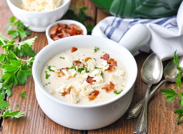 Horizontal shot of a bowl of New England Clam Chowder with bacon on top