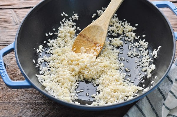 Adding rice to cast iron skillet for risotto