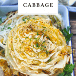 Close up shot of roasted cabbage steaks with a text title at the top of the image