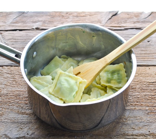 Cooked fresh ravioli in a pot