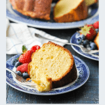 Front shot of a slice of sour cream pound cake with the title in text below the photo