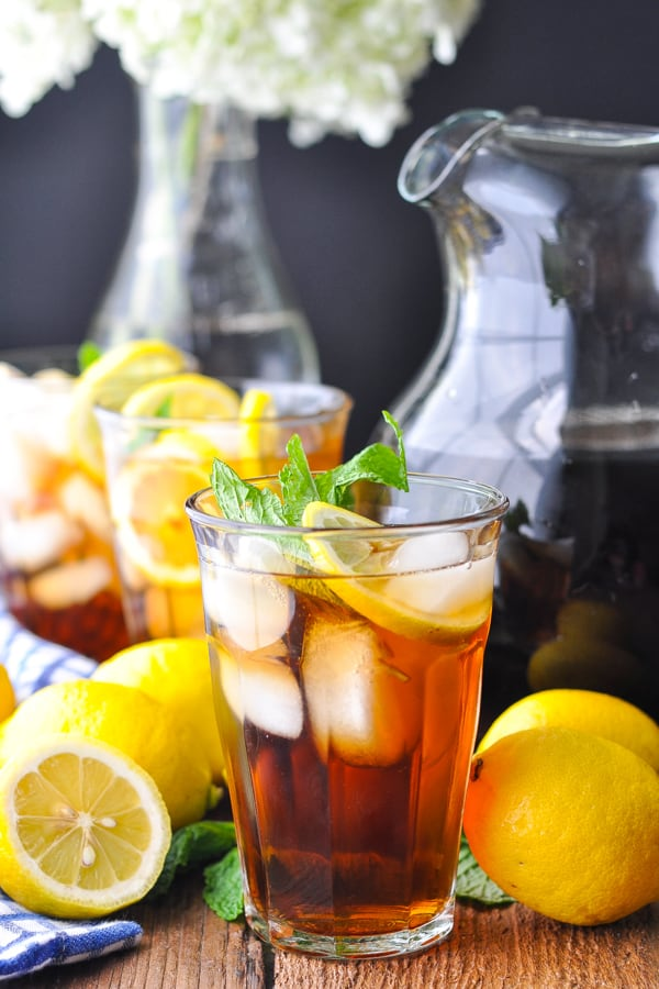 Front shot of three glasses of sweet tea with a pitcher in the background
