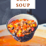 Ladle full of beef soup with a text title box at the top