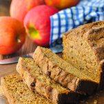 Apple bread with applesauce on a wooden cutting board