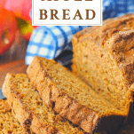 Close up shot of a sliced loaf of apple bread with a text title box at the top