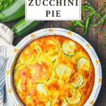 Overhead image of Bisquick Zucchini Pie on a wooden table with title at the top of the image