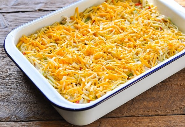 Grated cheese on top of spaghetti casserole