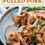 Close up shot of a bowl of cider braised pulled pork with text title at the top