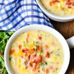 Overhead shot of corn chowder recipe served in a white bowl with bacon on top
