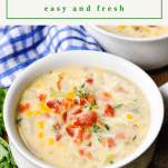 Side shot of corn chowder with bacon and a text title at the top