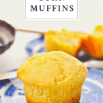 Single corn muffin on a plate with a text title at the top of the image