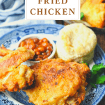 Crispy fried chicken recipe on a blue and white plate with text title at the top
