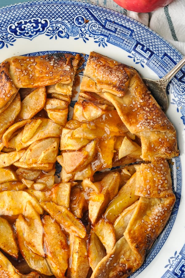 Close up shot of a slice of apple galette being cut