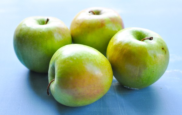 Granny Smith apples on a blue table