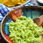 Close up front shot of an easy guacamole recipe served in a colorful bowl