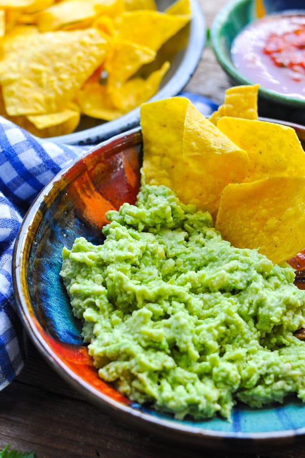Front shot of homemade authentic guacamole with tortilla chips