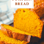 Close up front shot of the best pumpkin bread sliced with a text title at the top of the image