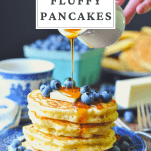 Front shot of a stack of buttermilk fluffy pancakes with text title at the top