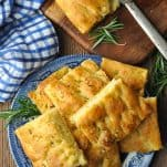 Overhead image of focaccia bread recipe served on a blue and white plate
